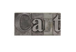 old, inkstained metal type letters form the word 'Cart'
