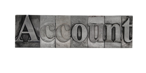 old, inkstained metal type letters form the word 'Account'