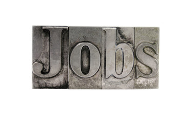 the word 'Jobs' in old, inkstained metal type
