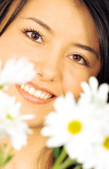 beautiful girl with white flowers in front of her face