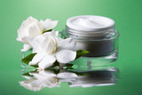 Container of opened moisturizing face cream poster