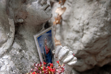 A crumbling icon of the virgin mary