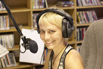 Young girl as announcer and dj at small broadcasting station
