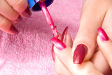 Young woman with beautiful long nails make the manicure poster