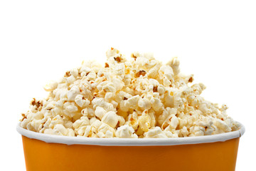 Detail of popcorn in a bucket over a white background