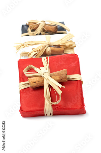 Three gifts with shadow on white background. Shallow DOF