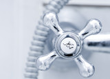 Bath tap with hot sign  close up