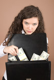 Young businesswoman with money isolated on beige poster