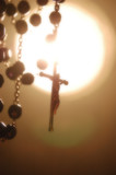 Rosary Backlighting in Mystical Atmosphere poster