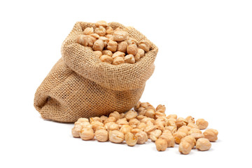 Burlap sack with chickpeas spilling out over a white background