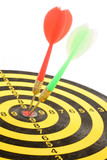 darts on a dartboard, concept of success poster