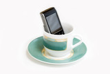 Coffee-cup and in it smartphone poster