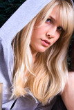 blond young woman in hood jacket poster