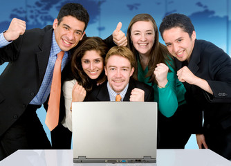Business success team in an office in front of a laptop