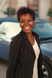 Happy African American businesswoman with new car purchase poster