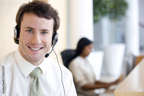 Young businessman with headset in office