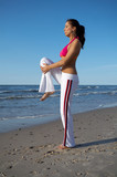 20-25 years old Beautiful Woman on the beach, during jogging poster