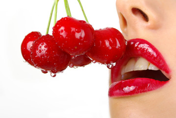 picture of cherry and lips over white