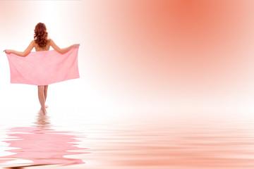 Young beautiful girl in towel in water
