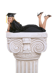 A beautiful woman  graduate laying on an architectural column