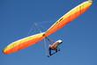 Leinwanddruck Bild - Orange-yellow hang-glider in the steep turn