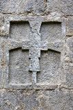 Cross in a wall. Monastery of Sant Pere in Camprodon, Catalonia poster