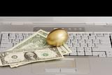 Golden egg, money on a laptop / online profits poster