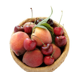 peaches and cherries in a basket