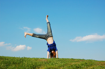Cartwheel on meadow on a background blue sky