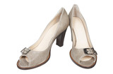 Beige female shoes on a white background poster