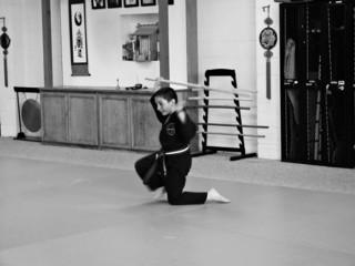Kempo Student -- Overhead Sweep (kneeling)