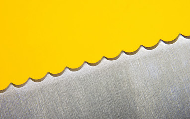 extreme close up of a stainless steel serrated knife