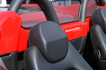 red convertible supercar head rest