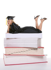 A beautiful young woman graduate on books