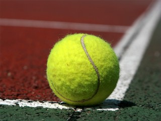 Tennis ball in the corner of a tennis field