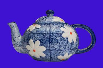 blue teapot over black background