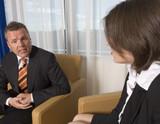 A businessman an businesswoman having a conversation poster