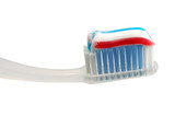Toothbrush with some toothpaste on it, isolated over white  poster