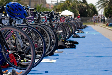Group of Bikes' wheels in a row  in a triathlon competition.