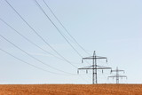 Summer field with transmission poles and sky poster