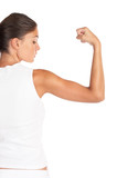 Beautiful woman flexing biceps - high key shot in studio poster