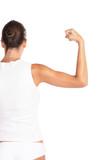 Beautiful woman flexing biceps - high key shot in studio poster