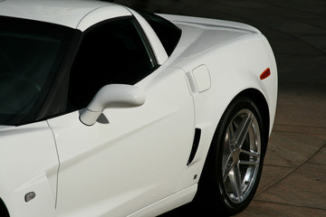 backend of a white muscle car