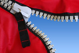 Detail of an opened zipper revealing a clear blue sky. poster