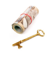 a roll of canadian dollars and golden key