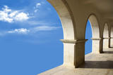 Ethereal image with marble arcades in a blue sky. poster