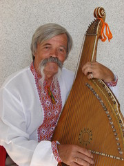 Senior ukrainian musician with bandura 10