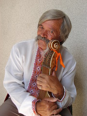 Senior ukrainian musician with bandura 5