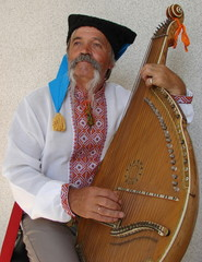 Senior ukrainian musician with bandura 3