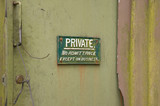 Dirty, Grungy old entrance door with a Private sign. poster